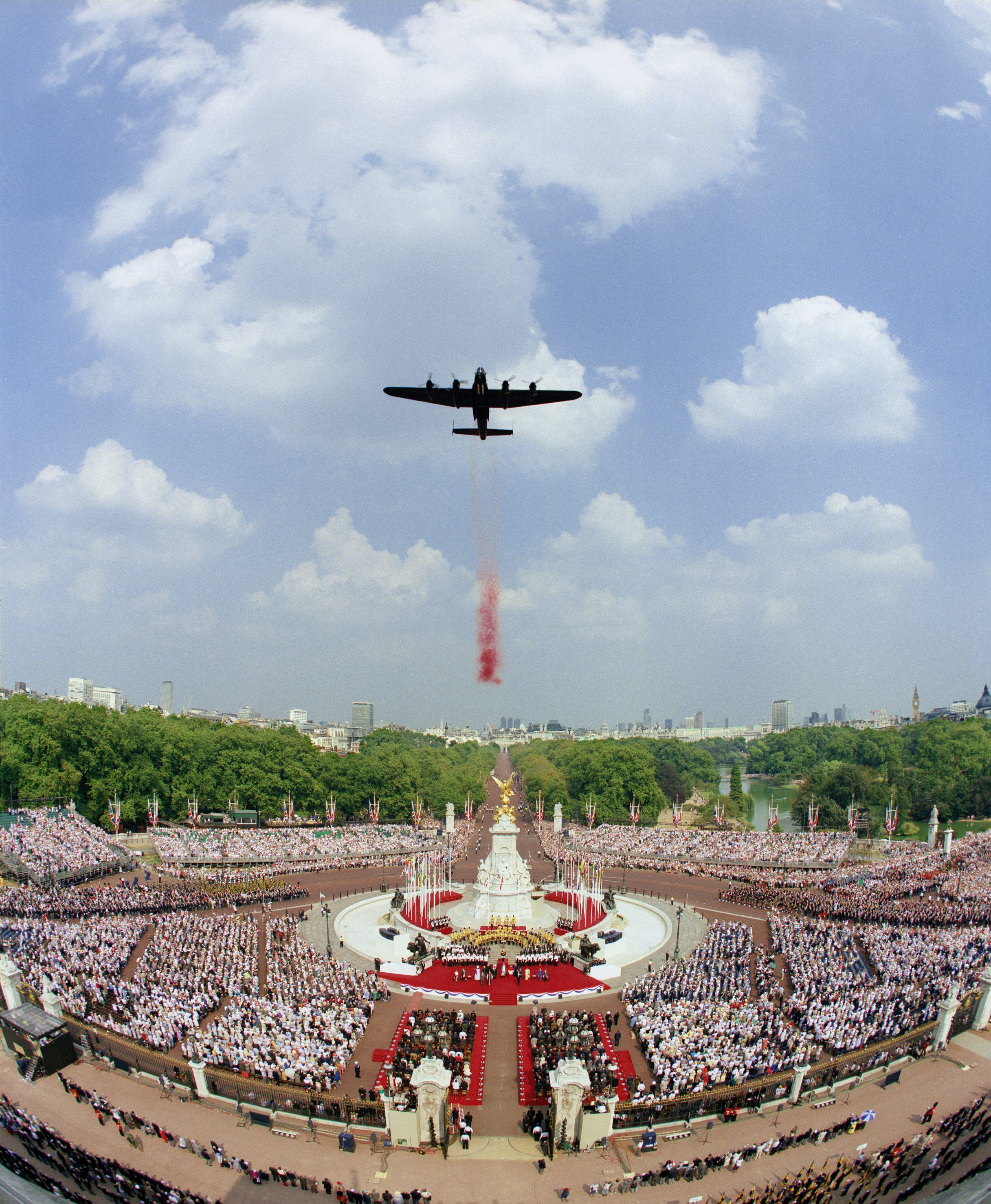 A Lancaster from the RAF Battle of Britain Memorial Flight drops poppies over London during the 50th Anniversary of the VE Day Celebrations in 1995.