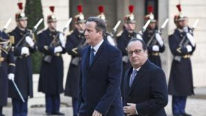 Britain's Prime Minister David Cameron, left, and France's President Francois Hollande arrive at the Elysee Palace in Paris, Monday, Nov. 23, 2015. French President Francois Hollande and British Prime Minister David Cameron have paid a visit to the Bataclan concert venue in central Paris, which saw the worst carnage of the Paris attacks that killed over 120 people. (AP Photo/Michel Euler)