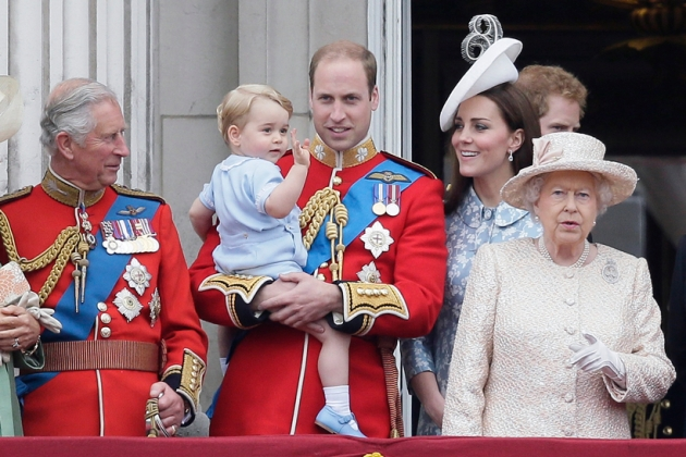 FILE - In this Saturday, June 13, 2015 file photo, Britain's Prince William holds his son Prince George, with Queen Elizabeth II, right, Kate, Duchess of Cambridge and the Prince of Wales during the Trooping The Colour parade at Buckingham Palace, in London. Britain's Queen Elizabeth celebrates her 90th birthday on Thursday, April 21, 2016. (AP Photo/Tim Ireland, file)