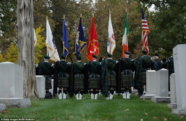 The Shannon Rovers from Chicago perform bagpipe music during the graveside service for Maureen O'Hara