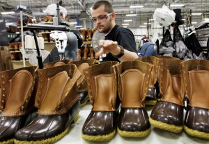 """FILE-In this Dec. 14, 2011 file photo, Eric Rego stitches boots in the facility where LL Bean boots are assembled in Brunswick, Maine. LL Bean CEO Chris McCormick told workers that the Maine-based retailer has been conservative for the past few years and is now ready to """"accelerate our growth plans and grab market share."""" That plan includes pumping an additional $100 million into its website, retail expansion and business systems, he said. (AP Photo/Pat Wellenbach, files)"""
