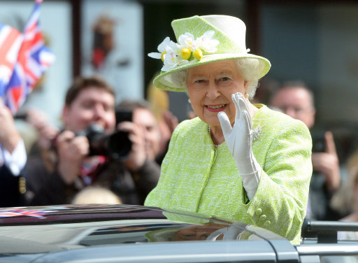 Queen Elizabeth II waves to well wishers from a open top Range Rover in Windsor, Berkshire, as she celebrates her 90th birthday.